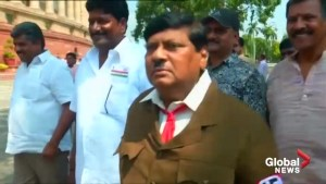 Indian politician dresses up as Hitler outside parliament