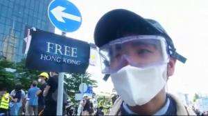 Tear gas fired as Hong Kong protesters storm parliament
