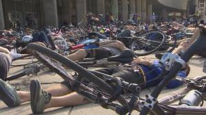 Toronto cyclists protest for safer roads in front of City Hall