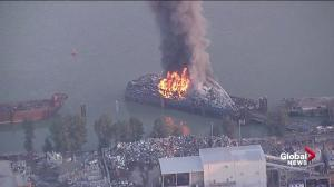 Fire raging on barge at industrial site in Surrey