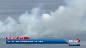 Wildfire burning out of control near Cochrane