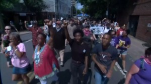 Protestors march through Charlottesville to recognize last year's deadly gathering