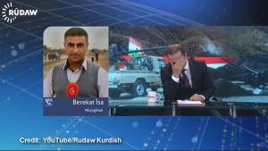 Anchor and report breakdown on live TV discussing Yazidis plight in Iraq
