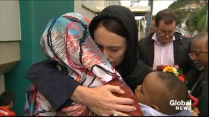 New Zealand PM Jacinda Ardern lays wreath at mosque, embraces mourners of Christchurch