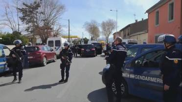 French police officer who offered himself to gunman in exchange for