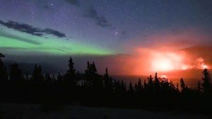Time-lapse shows Northern Lights swirling next to raging wildfire in Canada