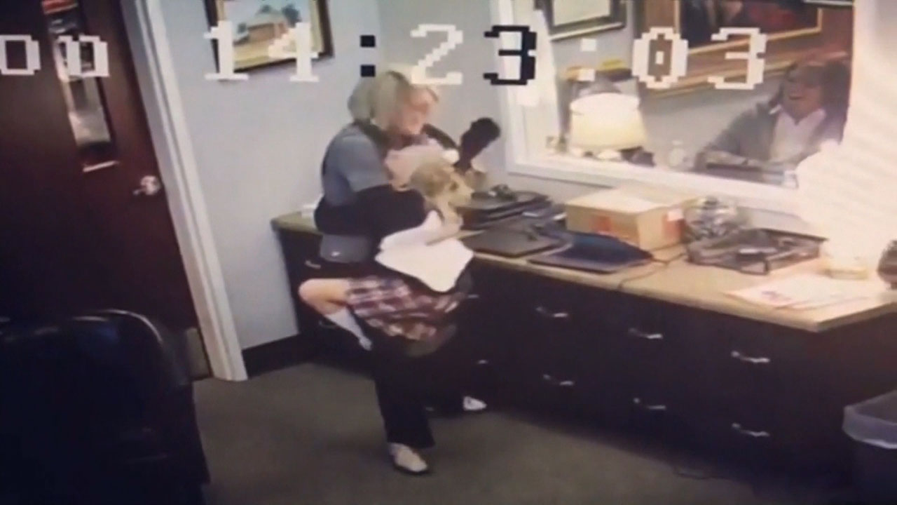 Girl's heartwarming adoption surprise caught on tape