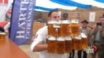 German sets new world record for carrying beer steins
