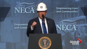 Donald Trump tries on hard hat at electrical contractors convention