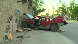 Two sent to hospital after pickup trucks crash in Winnipeg's West End