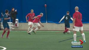 Edmonton Police Service takes to pitch for Woodall Cup