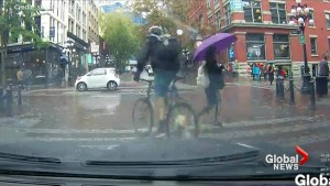 YouTube video shows Gastown cyclist nearly hitting pedestrian