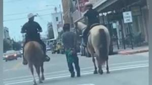 More video emerges of police on horseback leading man via rope in Texas