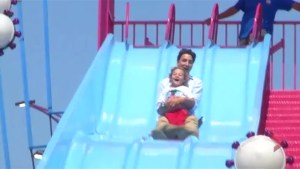 Justin Trudeau rides slide with son Hadrien at strawberry social