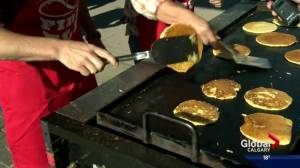 Tourism Calgary flips the first pancakes of Calgary Stampede