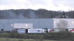 Gunfire and explosion heard at warehouse north of Paris where suspects are holed up