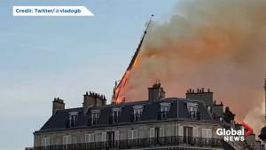 Notre Dame spire collapses as fire rips through cathedral