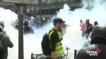 Protesters shake van, dodge tear gas at Paris May Day rally