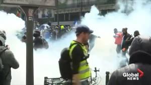 Protesters shake van, dodge tear gas at Paris May Day rally