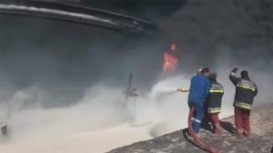 Libyan firefighters battle oil tanks blaze