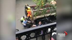 Houston neighbours form human chain to help pregnant woman evacuate hurricane