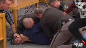Chaos erupts in Larry Nassar sentencing as victim's father tries to attack him in court