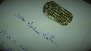 Dog tag found on Utah Beach returned to Indiana widow after 70 years