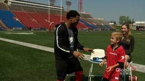 Junior reporter Marcus interviews Stamps running back Don Jackson