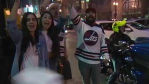 Jets fans celebrate game 1 victory