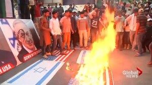 Protesters set U.S. flags alight in Pakistan over opening of embassy in Jerusalem