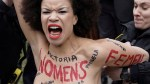Topless female protester arrested outside Bill Cosby trial