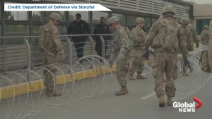 U.S. troops lay barbed wire at Mexico border