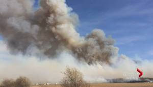 Wildfires prompt states of emergency in three provinces