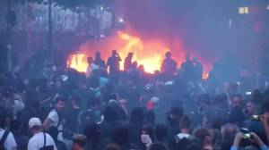 Fires lit throughout streets in Hamburg, Germany as police use water cannons to combat G20 protesters