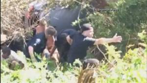 Bystanders form human chain to save man trapped inside burning car