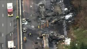 Daylight reveals charred vehicles involved in deadly Highway 400 crash
