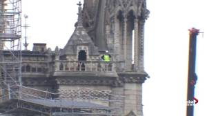 Notre Dame fire: Workers in cherry picker survey rooftop fire damage