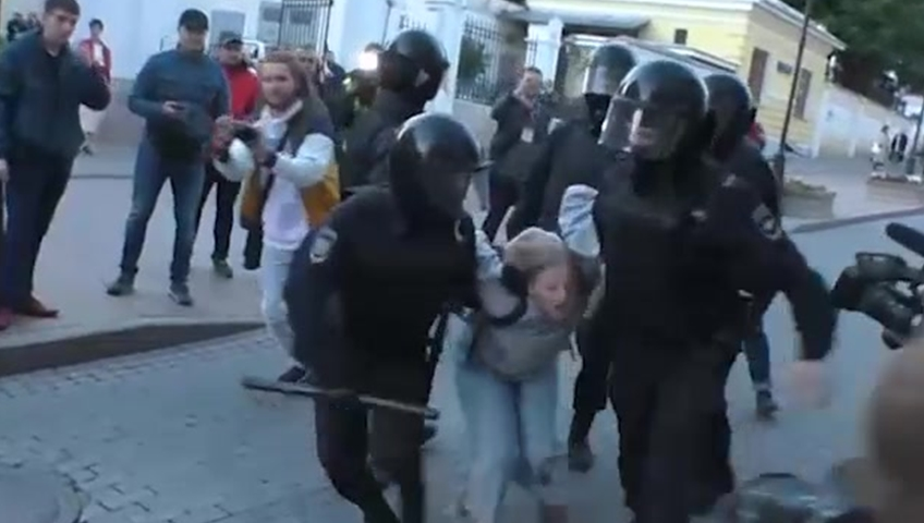 Russian Police Accused Of Excessive Force For Punching Female Protester In Custody