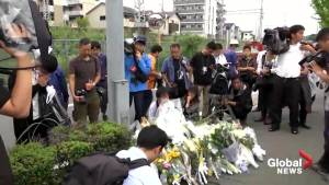 Flowers laid in tribute outside studio in Kyoto, Japan following deadly fire