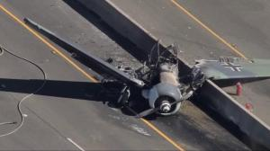 Replica WWII plane crashes onto California highway, walks away