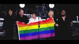 Sir Paul McCartney holds up Pride flag during concert in Germany in support of Orlando victims