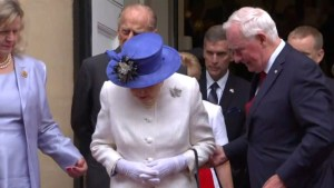 Governor General criticized in British media for touching the Queen