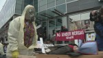 Anti Kinder Morgan protestors 'die' in front of government office