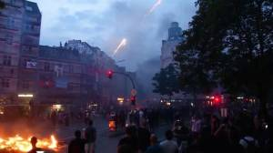 G20 protesters shoot off fireworks as fires burn in the streets of Hamburg, Germany