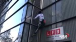 French 'Spider-Man' climbs London's Heron Tower