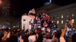 Toronto Raptors fans climb and slide on transport truck as celebrations continue over Game 6 win