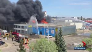 Crews battle fire at west Edmonton commercial building
