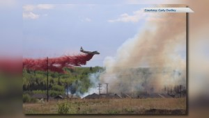 "Wildfire just outside Cochrane ""being held"""