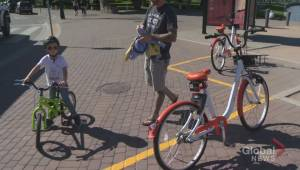 How has the bike share program in Kelowna fared this summer?