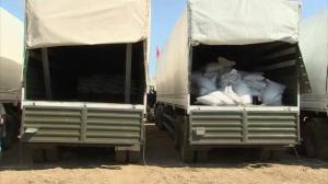 Raw video: Russian aid convoy prepares to cross border into Ukraine